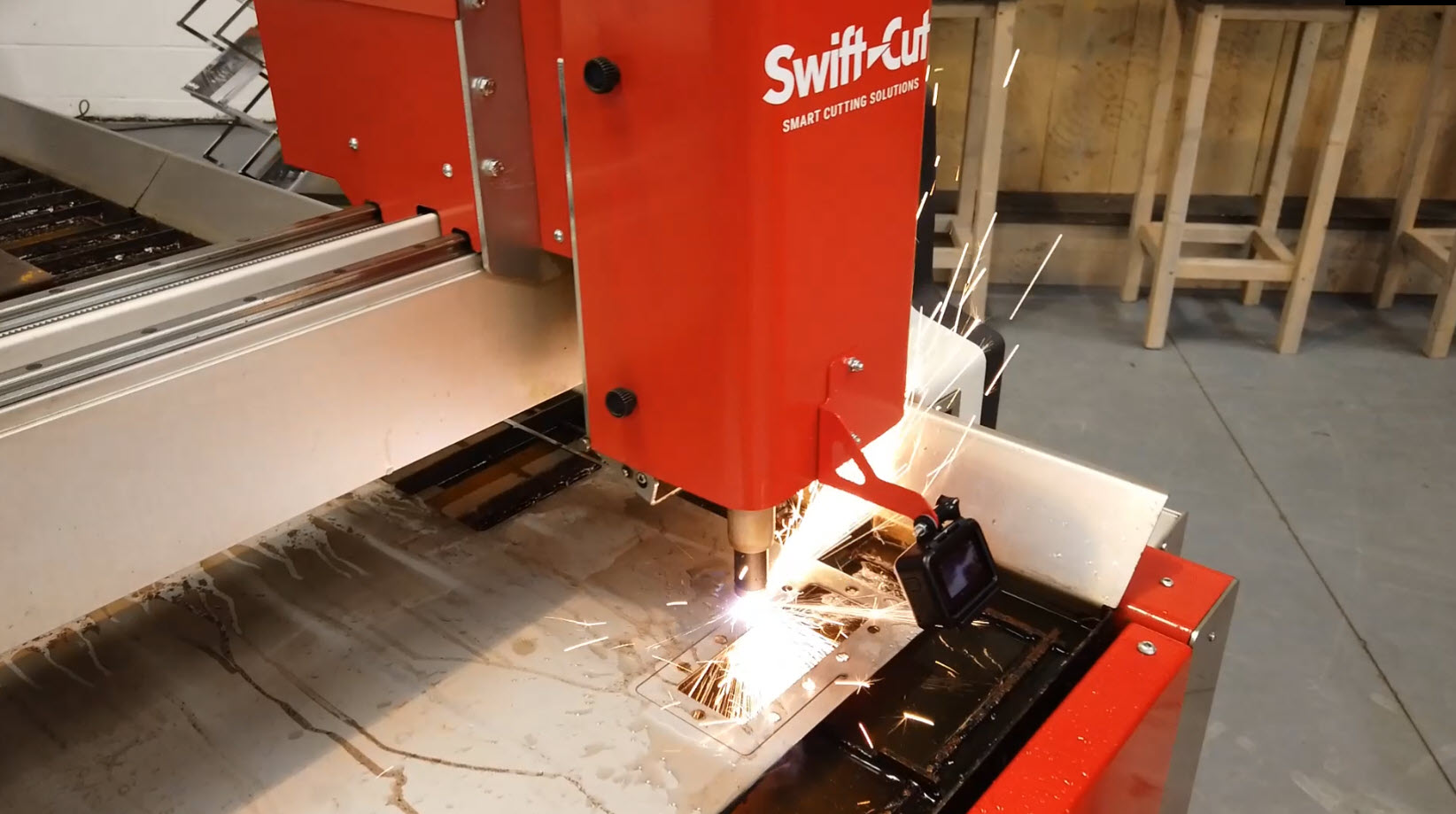 Swift-Cut Pro 1.5mm CNC cutting table cutting metal with sparks