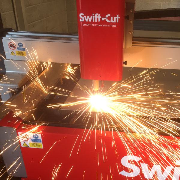 Swift-Cut Pro CNC plasma cutting table in action with sparks